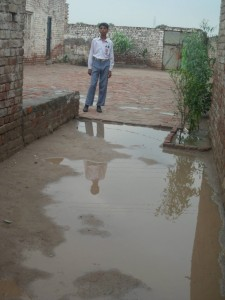 a boy stands in the courtyard of school looking at water on 28 sep 2013