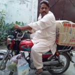 Grocery shopping by motorcycle.