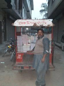 school books loaded onto a motor bike cart