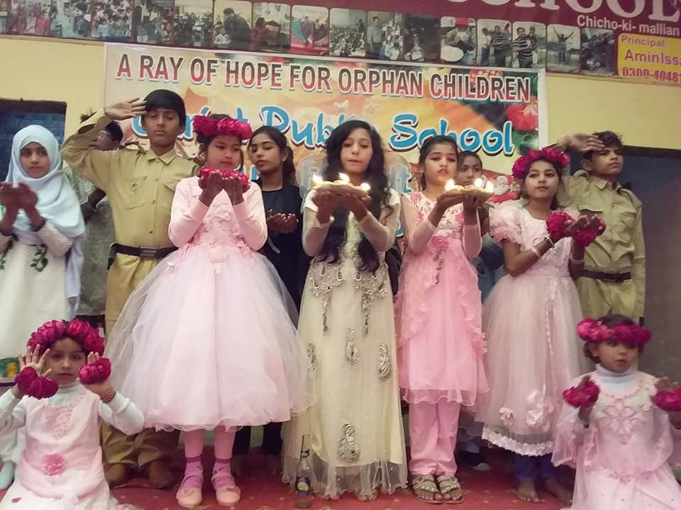 children pose on stage