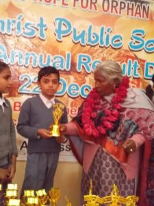 boy holding a trophy