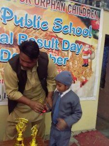 boy receiving a trophy