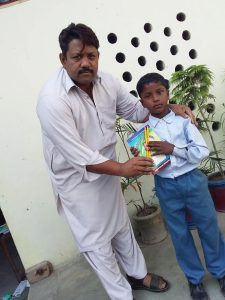 Presenting Notebook to a boy.