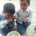 boys enjoying food